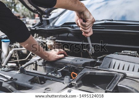 Services car engine machine concept, Automobile mechanic repairman hands repairing a car engine automotive workshop with a wrench, car service and maintenance. #1495124018