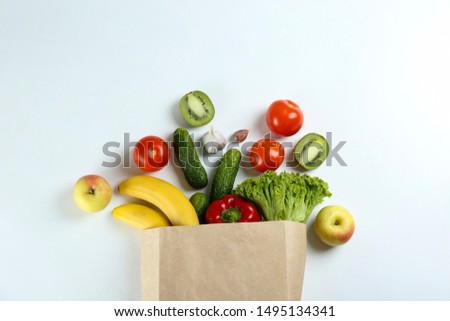 Bunch of mixed organic fruits, vegetables & greens, gourmet pile in full eco friendly shopping bag to reduce ecological footprint. Zero waste concept. White table background, copy space, close up. #1495134341