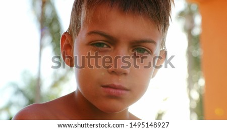 Handsome young boy child looking to camera outside looking to camera #1495148927