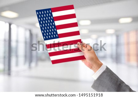 Man Holding Flag of USA. USA in Hand. #1495151918