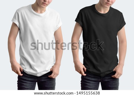 Mockup white and black t-shirt with rolled up sleeves on a young guy. Template isolated on a white background. #1495155638