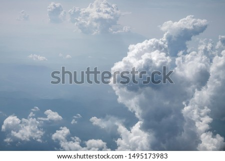 Sky with clouds. The mountainous landscape is faintly visible under the clouds. The view from the top. Royalty-Free Stock Photo #1495173983