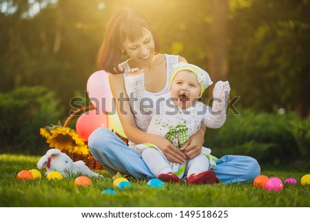 baby and mom are playing on the green grass #149518625