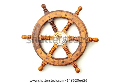 Navigation, nostalgia for bygone age of discovery and leadership conceptual idea with vintage ship steering wheel rudder made of wood and brass isolated on white background with clipping path cutout #1495206626