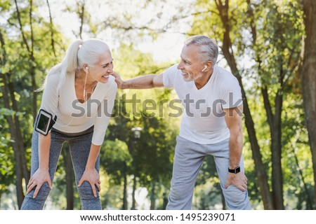 Senior couple resting after workout outdoors #1495239071