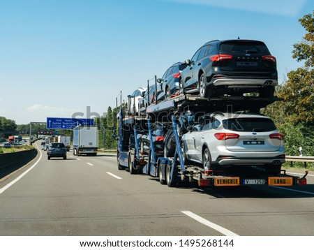 Germany - Aug 22, 2019: Trucks carrying multiple Ford Focus cars on the platform delivery cargo #1495268144