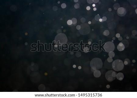 Fantasy bokeh sparkle from light on black background #1495315736
