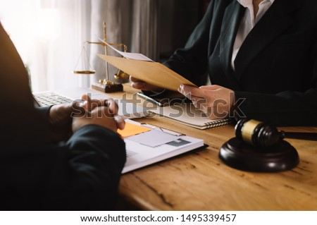 Business and lawyers discussing contract papers with brass scale on desk in office. Law, legal services, advice,  justice and law concept .  #1495339457