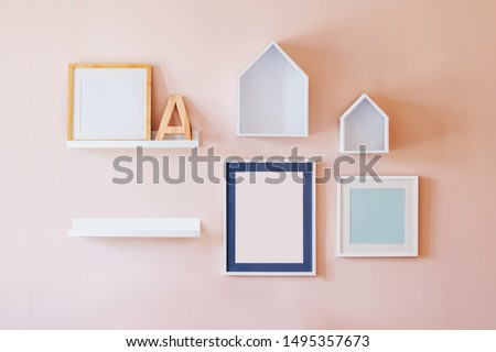 Mini house shape and alphabet wood and frame hanging on  wall