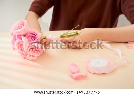 People making paper craft flower art  #1495379795