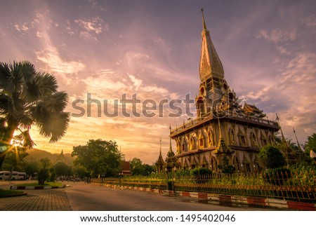 Phra Mahathat Jaydee, Phra Chom Thai, located in Chalong Temple or Chaithararam Temple in Phuket, recorded photos during the setting sun
