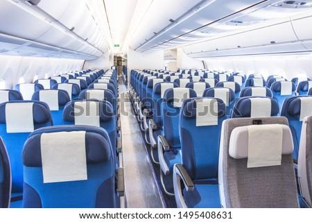 Passenger seats interior of salon view of the interior of an empty passageway #1495408631