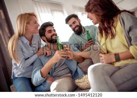 Friends watching football game on tv  and having great time together.Friendship, holidays, food and celebration concept. #1495412120