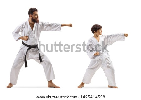 Full length shot of a boy and man practicing karate kata isolated on white background #1495414598