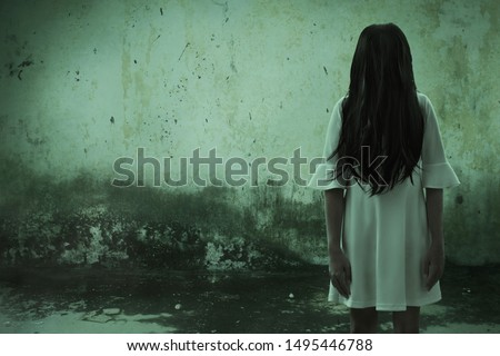 Scary ghost woman in haunted house Royalty-Free Stock Photo #1495446788