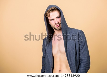 Masculinity concept. Masculinity and confidence. Man muscular torso wear hooded clothes. Unconventional but masculine look. Brute masculinity extremely commanding looking conventionally handsome. #1495518920