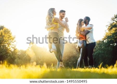 Group of people dancing Kizomba in golden sunset #1495550495