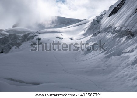 Climbers on their way to Belukha summit, the highest mountain in Altay mountain ridge in Siberia. Panoramic view of surrounding Altay Mountains with snow, glaciers and crevasses. #1495587791