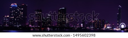 Defocus panorama background futuristic cyberpunk night cityscape building with star inthe sky. #1495602398