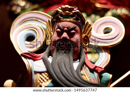 Face of an ancient Chinese warrior statue or god Chinese #1495637747