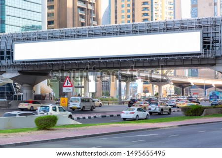 Advertisement mockup. Blank empty billboards on the city street in Dubai, UAE.