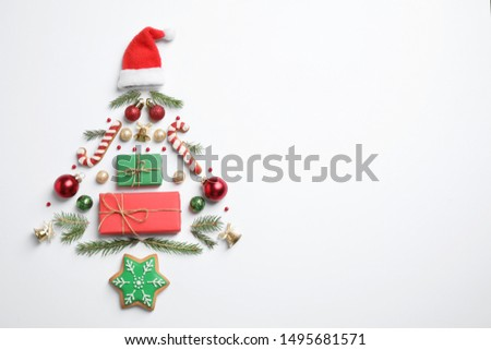 Christmas tree silhouette of fir branches and festive decoration on white background, top view