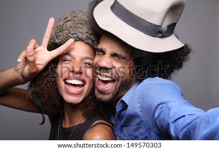 Happy couple in a photo booth