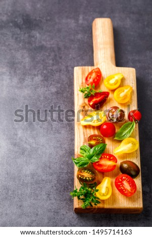 Cherry tomatoes. Summer variety of healthy vegetable colors. Food for Vegetarian.Copy space for Text  #1495714163