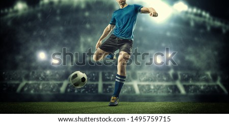 Soccer player in action on a dark background #1495759715