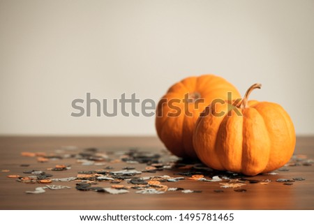 Thanksgiving background with pumpkin on wooden table, design with copy space for text, advertising and banner, soft focus.
