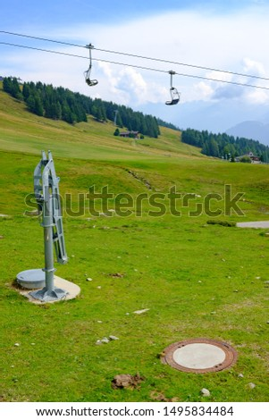 chairlift in the austrian alps, snow gun #1495834484