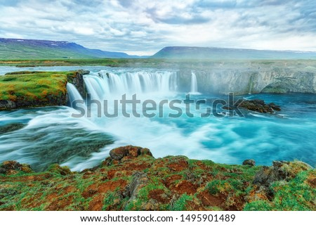 Godafoss waterfall, Iceland. Amazing long exposure scenery of famous landmark in Iceland - waterfall Godafoss. Popular tourist landmark, travel destination in Iceland. #1495901489