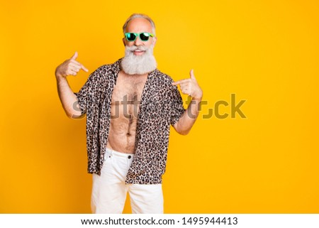 Photo of cheerful nice old man pointing at himself to show you his handsomeness while isolated with yellow background #1495944413
