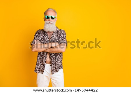 Photo of old confident man seeming to be businessman having rest abroad while isolated with yellow background #1495944422