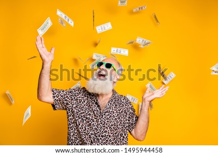 Portrait of crazy funky funny oold bearded man hipster in green eyeglasses eyewear look up at money falling scream great win lottery wear leopard stylish shirt isolated over yellow background #1495944458