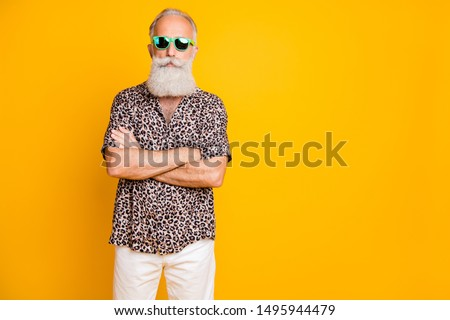 Portrait of concentrated modern retired old bearded businessman on rest resort look funny funky wear leopard print shirts pants trendy outfit isolated over yellow background #1495944479