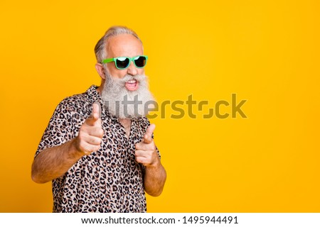 Hey you! Portrait of funky old bearded man in eyeglasses eyewear  feel cool crazy point at you  wearing leopard shirt isolated over yellow background #1495944491
