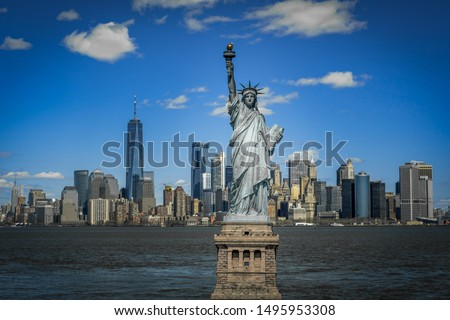 The Statue of Liberty over the Scene of New york cityscape river side which location is lower manhattan,Architecture and building with tourist concept #1495953308