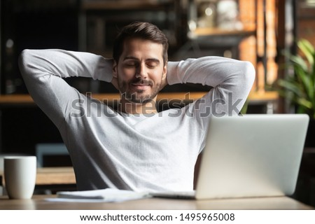 Relaxed happy businessman student worker lounge at work desk cafe table meditating, positive calm man relax break hold hand behind head dream rest from computer stretch feel no stress peace of mind #1495965008