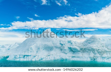 Global warming - Greenland Iceberg landscape of Ilulissat icefjord with giant icebergs. Icebergs from melting glacier. Arctic nature heavily affected by climate change #1496026202