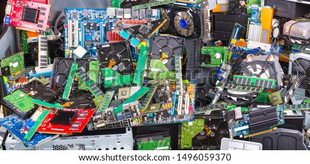 Used computer and laptop parts for e-waste recycling. Large colored heap of electronic, plastic and metal refuse from old discarded or obsolete PC components. Ecological danger. Full depth of field. #1496059370