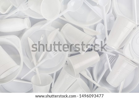 Food plastic on grey background. Concept of Recycling plastic and ecology. Plastic waste. Flat lay, top view #1496093477