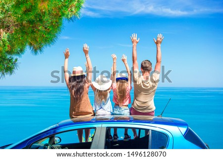 Parents and two little kids on summer car vacation #1496128070