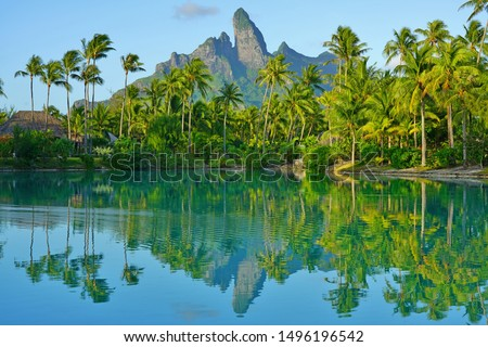 View of the Mont Otemanu mountain reflecting in water at sunset in Bora Bora, French Polynesia, South Pacific #1496196542