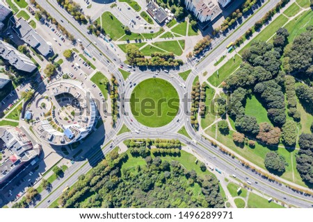 city street roundabout with little traffic of cars in summer time. aerial top view  #1496289971