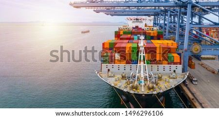 Container ship terminal, Unloading and quay crane of container ship at industrial port with shipping container vessel, Maritime cargo freight ship import export business logistic transportation. #1496296106