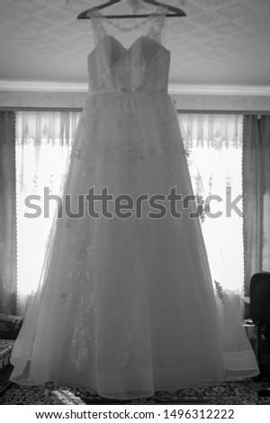 Bride's dress. White dress. Grooming dress White dress in the center of the room. #1496312222