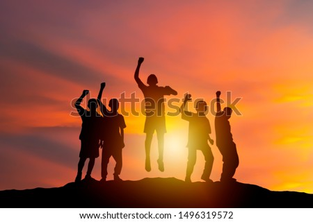 successful human and fighting spirit, Silhouette group young, people are delighted by show of hands higher. succeed. Business, successful, achievement, teamwork and goal concept. #1496319572