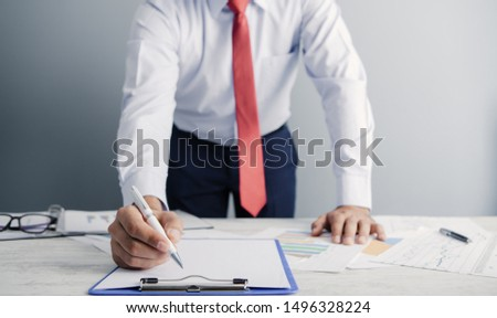 a businessman works at his office; business analysis #1496328224