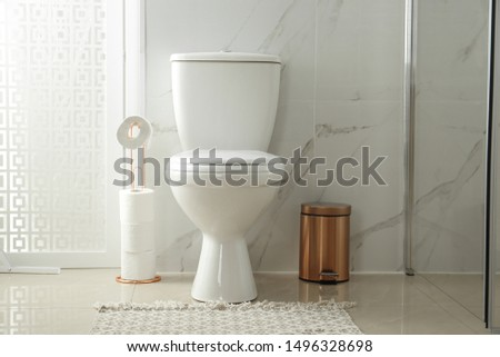Toilet bowl near shower stall in modern bathroom interior #1496328698